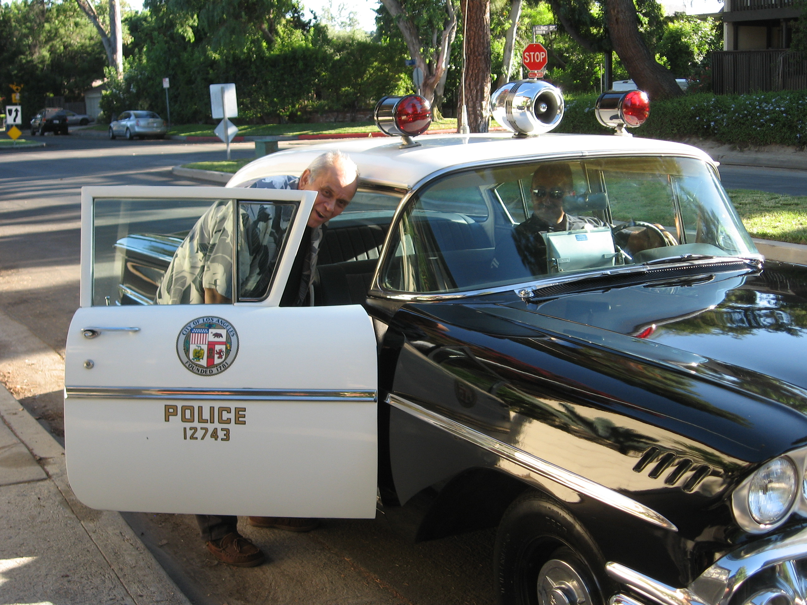 LAPD giving RJ a ride to a local event in their cool 1950's Chevy Police Car.